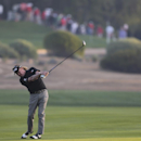 Miguel Angel Jimenez of Spain hits a shot on the 10th hole during the second round of the Abu Dhabi Championship golf tournament in Abu Dhabi, United Arab Emirates, Friday, Jan. 16, 2015. (AP Photo/Kamran Jebreili)