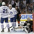 Toronto Maple Leafs' Tyler Bozak(42) celebrates with James van Riemsdyk(21) after he scored against Anaheim Ducks goalie Frederik Andersen, right, of Denmark, during the first period of an NHL hockey game on Monday, March 10, 2014, in Anaheim, Calif. (AP Photo/Jae C. Hong)