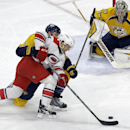 Carolina Hurricanes' Jay McClement tries to shoot as Nashville Predators' Shea Weber (6) and goalie Pekka Rinne (35), of Finland, defend during the third period of an NHL hockey game in Raleigh, N.C., Tuesday, Dec. 2, 2014. Carolina won 2-1 The Associated