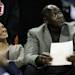 CHARLOTTE, NC - JANUARY 14:  Charlotte Bobcats owner, Michael Jordan sits beside fiance, Yvette Prieto during the Golden State Warriors versus Charlotte Bobcats game at Time Warner Cable Arena on January 14, 2012 in Charlotte, North Carolina.  (Photo by Streeter Lecka/Getty Images)