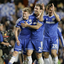 Chelaea's Andre Schuerrle, left, Branislav Ivanovic, centre, and Cesar Azpilicueta celebrate winning the Champions League second leg quarterfinal soccer match between Chelsea and Paris Saint-Germain at Stamford Bridge Stadium in London, Tuesday, April 8,