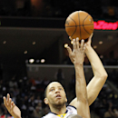 Memphis Grizzlies forward Tayshaun Prince, back, shoots over Minnesota Timberwolves forward Corey Brewer (13) in the second half of an NBA basketball game Monday, March 24, 2014, in Memphis, Tenn. The Grizzlies won 109-92 The Associated Press