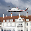 A helicopter owned by Donald Trump departs from the Turnberry golf course in Turnberry, Scotland, Wednesday, July 29, 2015. The Women's British Open golf championship is being held at Turnberry golf course from July 30 until Aug. 2. (AP Photo/Scott Heppell)