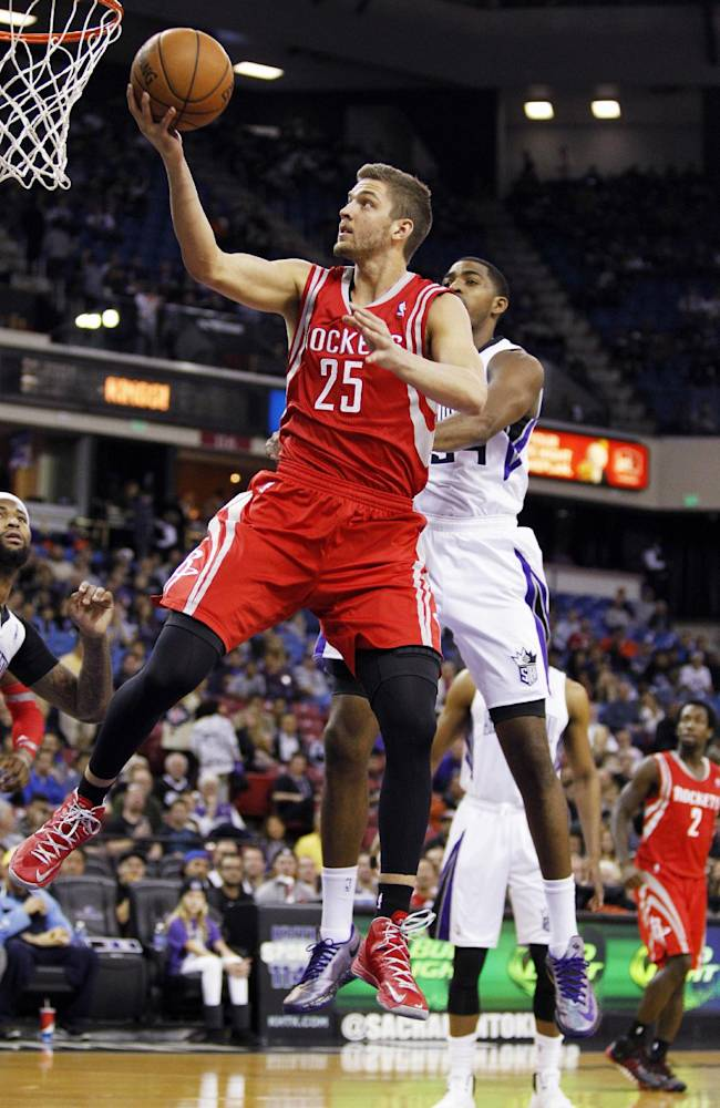 Houston Rockets forward Chandler Parsons (25) scores against Sacramento Kings forward Jason Thompson, right, during the first half of an NBA basketball game in Sacramento, Calif., Sunday, December 15, 2013
