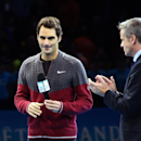 Switzerland's Roger Federer speaking to the crowd announcing his withdrawal from the final match of the ATP World Tour Finals tennis against Serbia's Novak Djokovic, due to injury in London, Sunday, Nov. 16, 2014. Federer talked to the crowd from the court to say he was sorry but he has a back injury. (AP Photo/Tim Ireland)