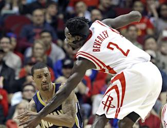 Indiana Pacers' George Hill (3) passes the ball beneath Houston Rockets' Patrick Beverley (2) in the first half of an NBA basketball game on Friday, March 7, 2014, in Houston. (AP Photo/Pat Sullivan)