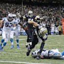 New Orleans Saints tight end Jimmy Graham (80) scores on a touchdown as Carolina Panthers cornerback Drayton Florence tries to tackle in the second half of an NFL football game in New Orleans, Sunday, Dec. 8, 2013 The Associated Press