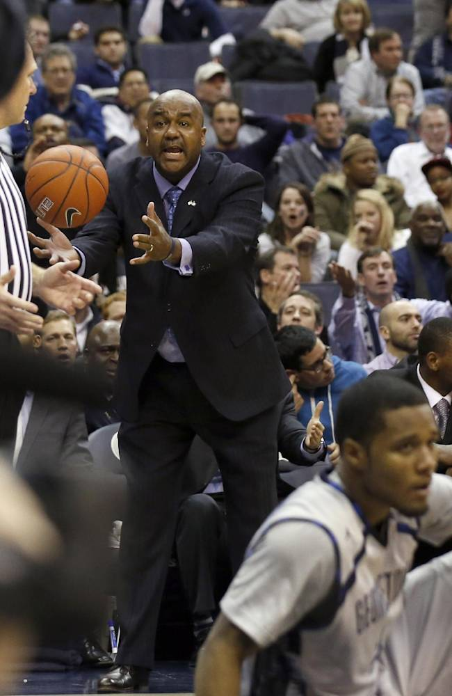 Georgetown head coach John Thompson III talks to an official after a play during the second half of an NCAA college basketball game against Villanova, Monday, Jan. 27, 2014, in Washington. Villanova won 65-60