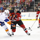 New York Islanders defenseman Thomas Hickey (14) and New Jersey Devils right wing Martin Havlat (9), of the Czech Republic, compete for the puck during the second period of an NHL hockey game, Friday, Jan. 9, 2015, in Newark, N.J The Associated Press
