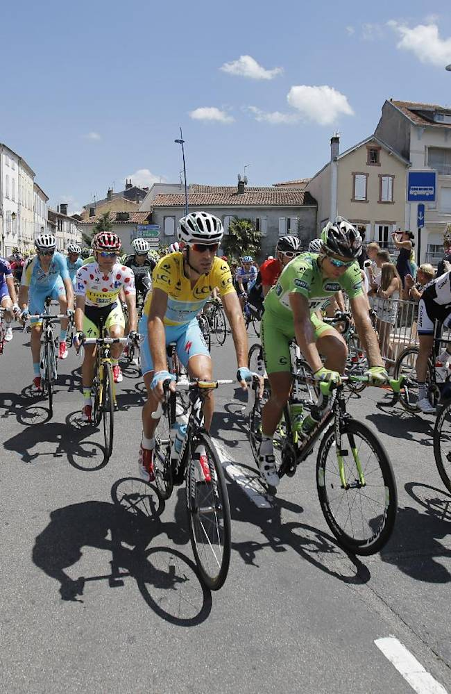 France's Thibaut Pinot, wearing the best young rider's white jersey, Poland's Rafal Majka, wearing the best climber's dotted jersey, Italy's Vincenzo Nibali, wearing the overall leader's yellow jersey, and Peter Sagan of Slovakia, wearing the best sprinter's green jersey, lead the pack during the ceremonial procession prior to the start of the seventeenth stage of the Tour de France cycling race over 124.5 kilometers (77.4 miles) with start in Saint-Gaudens and finish in Saint-Lary, France, Wednesday, July 23, 2014