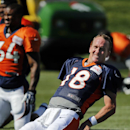 Denver Broncos quarterback Peyton Manning stretches during a joint practice between the Broncos and the Houston Texans on Wednesday, Aug. 20, 2014, in Englewood, Colo The Associated Press