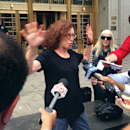 Courtroom sketch artist Jane Rosenberg is surrounded by the media outside of a federal courthouse in New York Monday, Aug. 31, 2015, after New England Patriots quarterback Tom Brady and NFL Commissioner Roger Goodell departed with no last-minute settlemen