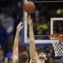 American center Tony Wroblicky (34) shoots over Kansas center Jeff Withey (5) during the first half of an NCAA college basketball game in Lawrence, Kan., Saturday, Dec. 29, 2012. (AP Photo/Orlin Wagner)