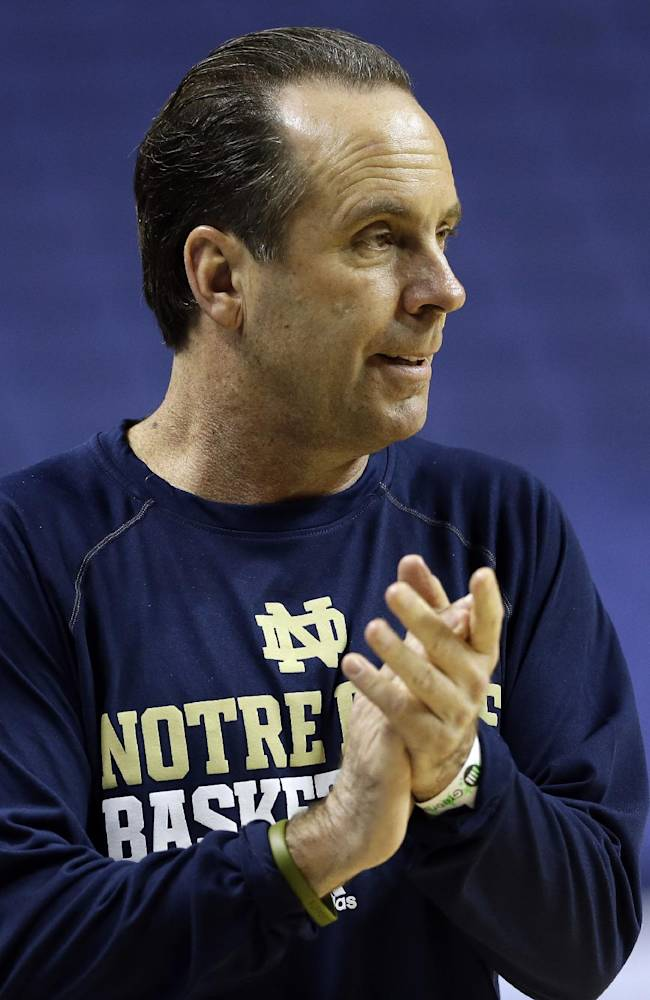Notre Dame coach Mike Brey applauds during an NCAA college basketball practice for the Atlantic Coast Conference tournament in Greensboro, N.C., Tuesday, March 11, 2014. Notre Dame plays Wake Forest in a first round game on Wednesday
