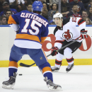 New Jersey Devils defenseman Peter Harrold (10) looks to pass against New York Islanders right wing Cal Clutterbuck (15) in the first period of an NHL hockey game on Saturday, March 29, 2014, in Uniondale, N.Y The Associated Press