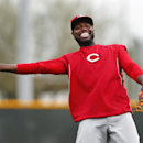 Cincinnati Reds second baseman Brandon Phillips laughs while throwing during spring training baseball practice in Goodyear, Ariz., Tuesday, Feb. 25, 2014 The Associated Press