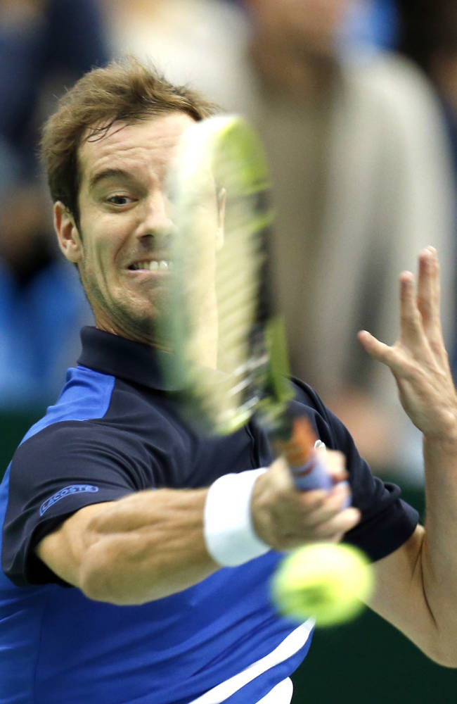 France's Richard Gasquet returns a ball to Kazakhstan's Mikhail Kukushkin during the  final match at the Kremlin Cup tennis tournament in Moscow, Russia, Sunday, Oct. 20, 2013