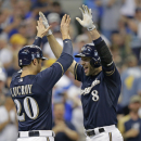 Braun, Lind hit 2-run HRs in 8th, Brewers hold off Twins The Associated Press