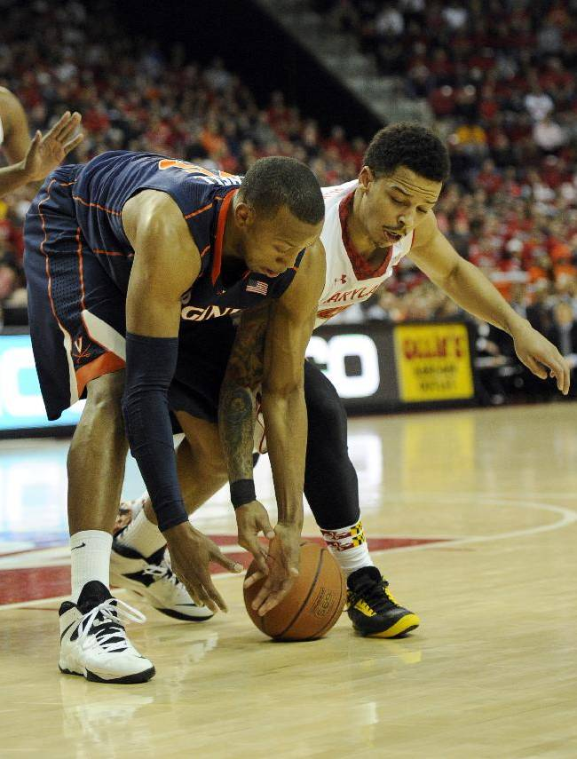 Maryland guard Seth Allen, right, fights for a loose ball against Virginia forward Akil Mitchell, left, during the first half of an NCAA college basketball game, Sunday, March 9, 2014, in College Park, Md