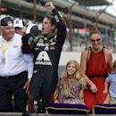 Jeff Gordon celebrates after winning the NASCAR Brickyard 400 auto race at Indianapolis Motor Speedway in Indianapolis, Sunday, July 27, 2014. At left is team owner Rick Hendrick. At right are Gordon's wife, Ingrid Vandebosch, and their children, Ella Sofia and Leo Benjamin. (AP Photo/R Brent Smith)