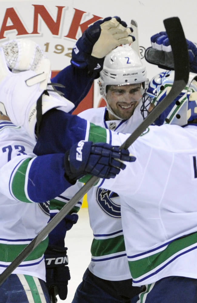 Canucks outlast struggling Devils 3-2 in shootout