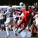 Queens Park Rangers' Armand Traore, left, competes for the ball with Liverpool's Glen Johnson during their English Premier League soccer match at Loftus Road, London, Sunday, Oct. 19, 2014