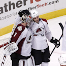 Colorado Avalanche center Ryan O'Reilly (90) celebrates with goalie Semyon Varlamov (1) the Avalanche's 2-0 win over the Chicago Blackhawks after an NHL hockey game Tuesday, Jan. 6, 2015, in Chicago The Associated Press