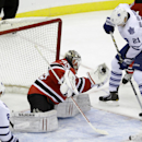 New Jersey Devils goalie Cory Schneider makes a glove save in front of Toronto Maple Leafs' James van Riemsdyk (21) during the third period of an NHL hockey game Sunday, March 23, 2014, in Newark, N.J. The Devils won 3-2 The Associated Press