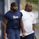 England Patriots middle linebacker Jerod Mayo, left, and defensive tackle Vince Wilfork (75) walk out to the field before practice begins at the NFL football team's facility Wednesday, Oct. 8, 2014 in Foxborough, Mass. The Patriots play the Buffalo Bills