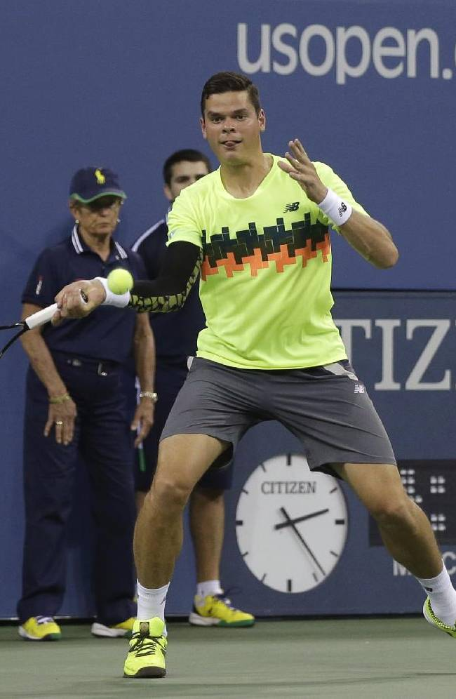 Milos Raonic, of Canada, returns a shot to Kei Nishikori, of Japan, during the fourth round of the 2014 U.S. Open tennis tournament Tuesday, Sept. 2, 2014, in New York