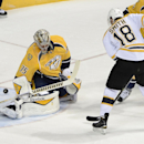 Nashville Predators goalie Pekka Rinne (35), of Finland, blocks a shot by Boston Bruins right wing Reilly Smith (18) in the first period of an NHL hockey game Tuesday, Dec. 16, 2014, in Nashville, Tenn The Associated Press