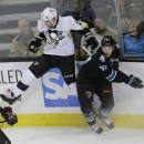 San Jose Sharks' Tommy Wingels (57) collides against the boards with Pittsburgh Penguins' Matt Niskanen (2) during the third period of an NHL hockey game on Thursday, March 6, 2014, in San Jose, Calif. San Jose won 5-3. (AP Photo/Marcio Jose Sanchez)