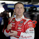 Kevin Harvick looks out of the garage before practice for Sunday's NASCAR Coca-Cola 600 Sprint Cup series auto race at Charlotte Motor Speedway in Concord, N.C., Thursday, May 21, 2015. (AP Photo/Chuck Burton)