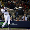 Atlanta Braves' Chris Johnson hits a single to score teammate Freddie Freeman in the fifth inning of a baseball game against the Washington Nationals, Friday, April 11, 2014, in Atlanta The Associated Press