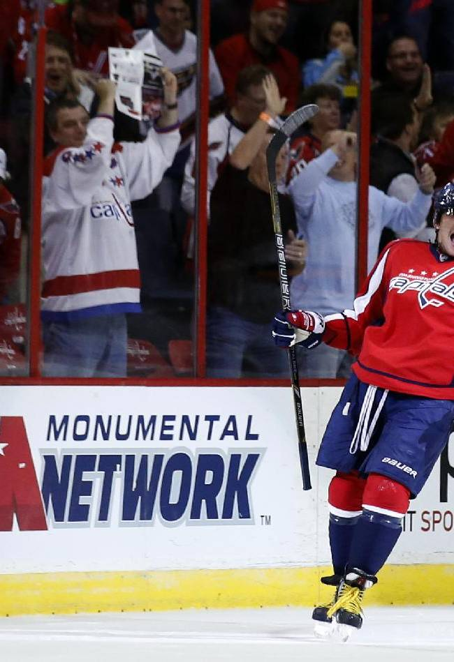Washington Capitals right wing Alex Ovechkin, from Russia, celebrates his goal in the first period of an NHL hockey game against the Minnesota Wild, Thursday, Nov. 7, 2013, in Washington