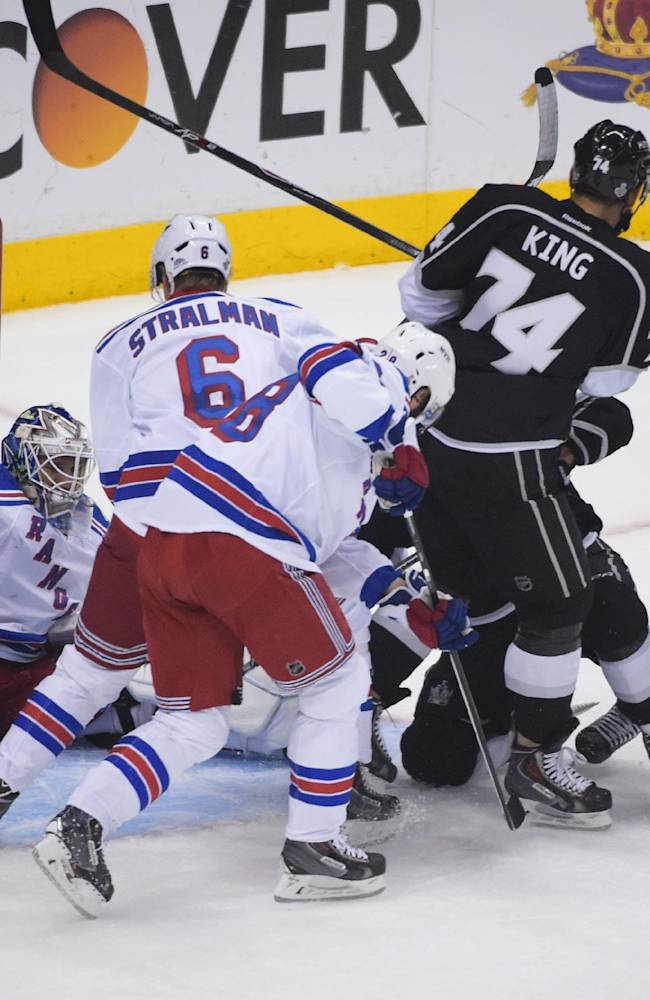 Los Angeles Kings right wing Justin Williams, right, watches as the puck enters the net, left, for a goal against the New York Rangers during the first period in Game 5 of the NHL Stanley Cup Final series Friday, June 13, 2014, in Los Angeles