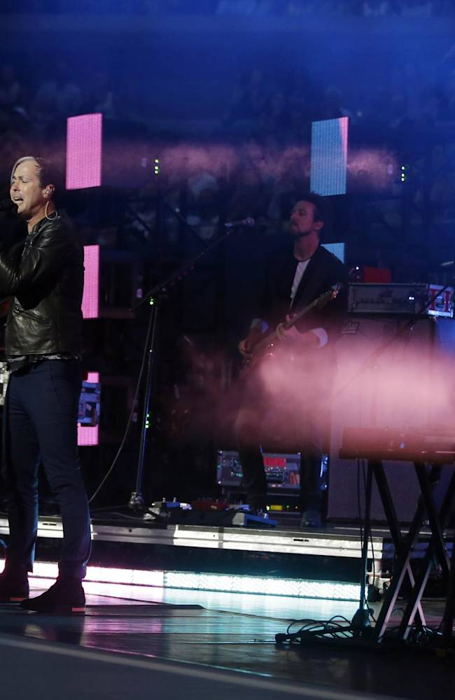 Singer Michael Fitzpatrick of the group Fitz and the Tantrums sings during the opening ceremony of the U.S. Open tennis tournament Monday, Aug. 25, 2014, in New York