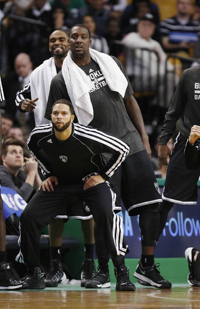 The Brooklyn Nets bench reacts to a missed shot late in the fourth quarter of a preseason NBA basketball game against the Boston Celtics in Boston, Wednesday, Oct. 23, 2013. The Celtics won 101-97