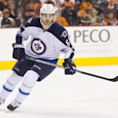 Winnipeg Jets' Michael Frolik in action during the second period of an NHL hockey game against the Philadelphia Flyers, Friday, Nov. 29, 2013, in Philadelphia. The Flyers win 2-1 The Associated Press
