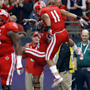 Louisiana-Lafayette wide receiver C.J. Bates, center, celebrates with wide receiver James Butler (11) after Bates caught a touchdown during the first half of the New Orleans Bowl NCAA college football game against Nevada in New Orleans, Saturday, Dec. 20,