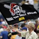 A Pittsburgh Pirates fan waves a banner attached to a broom after the Pirates completed a three-game sweep of the Chicago Cubs with a 4-2 win in a baseball game in Pittsburgh, Thursday, May 23, 2013. (AP Photo/Gene J. Puskar)