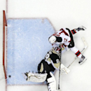 New Jersey Devils' Damien Brunner (12) has his shot under the pad of Pittsburgh Penguins goalie Marc-Andre Fleury (29) hit the goal post and bounce away from the net during the first period of an NHL hockey game in Pittsburgh Tuesday, Dec. 2, 2014. Fleury