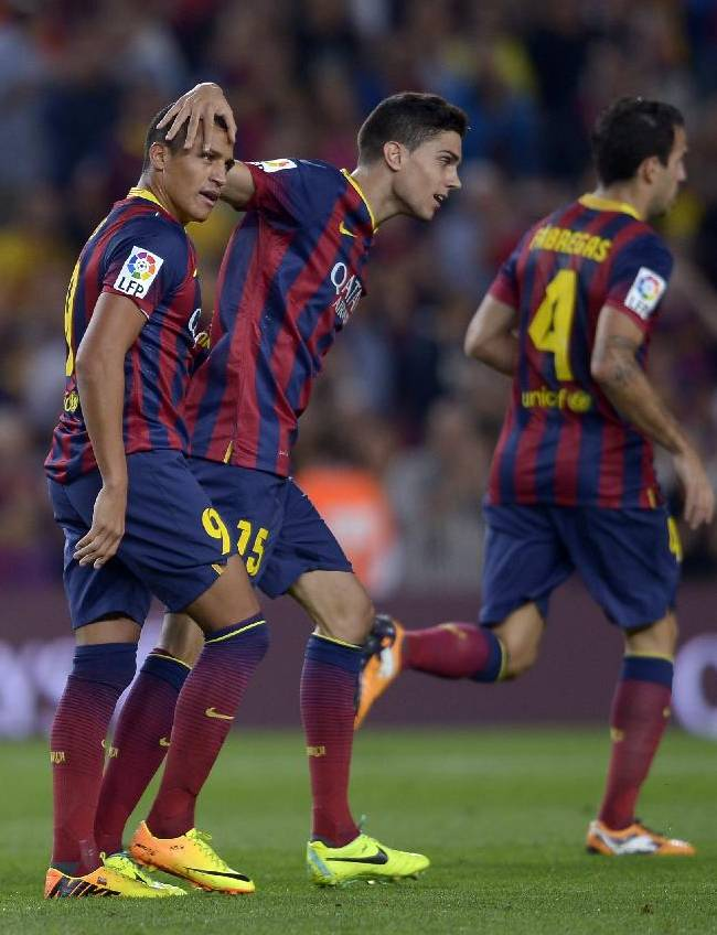 FC Barcelona's Alexis Sanchez, from Chile, left, reacts after scoring against Valladolid during a Spanish La Liga soccer match at the Camp Nou stadium in Barcelona, Spain, Sunday, Oct. 5, 2013