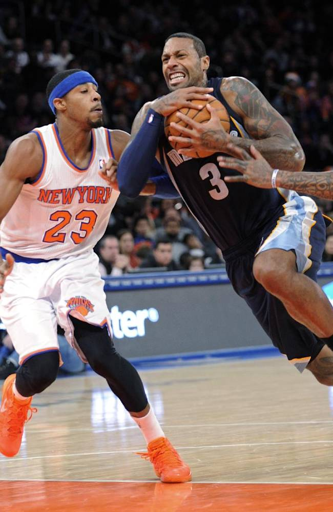 Memphis Grizzlies' James Johnson (3) drives to the basket between New York Knicks' Tore Murry (23) and J.R. Smith during the third quarter of an NBA basketball game Saturday, Dec. 21, 2013, at Madison Square Garden in New York. The Grizzlies defeated the Knicks 95-87