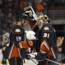 Anaheim Ducks center Ryan Getzlaf and goalie Frederik Andersen, of Denmark, congratulate each other after Getzlaf scored against the Carolina Hurricanes in overtime of an NHL hockey game, Tuesday, Feb. 3, 2015, in Anaheim, Calif. The Ducks won 5-4 The Ass