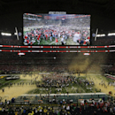 Ohio State players celebrate after the NCAA college football playoff championship game against Oregon Monday, Jan. 12, 2015, in Arlington, Texas. Ohio State won 42-20. (AP Photo/Morry Gash)