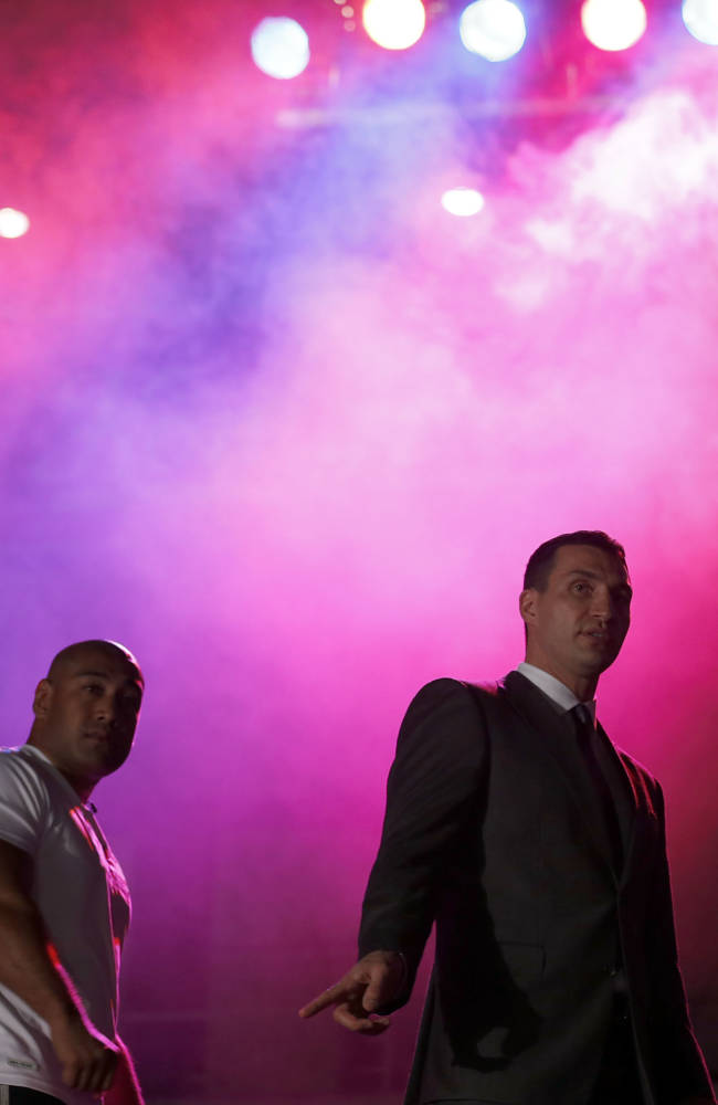 Wladimir Klitschko, right, and Alex Leapai pose for photographers after a press conference ahead of the IBF, IBO, WBO and WBA  heavyweight title bout on April 26,2014 between Wladimir Klitschko of Ukraine and Alex Leapai of Australia in Oberhausen, Germany, Tuesday, Feb. 11, 2014