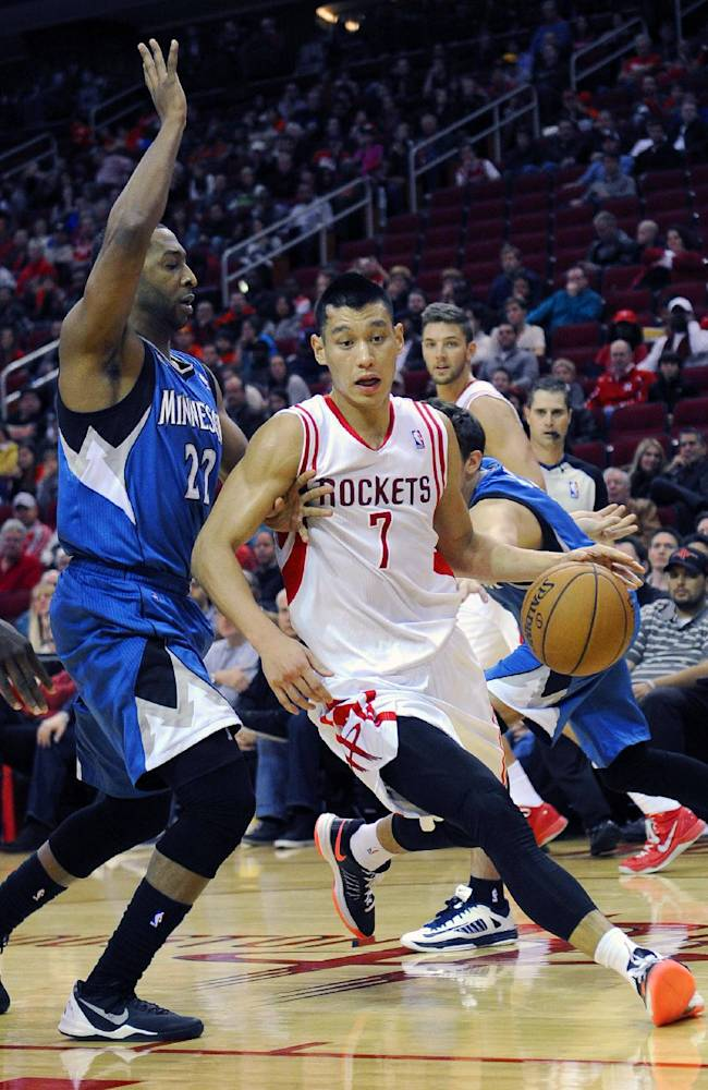 Houston Rockets' Jeremy Lin (7) drives the ball around Minnesota Timberwolves' A.J. Price (22) in the second half of an NBA basketball game Saturday, Nov. 23, 2013, in Houston. The Rockets won 112-101