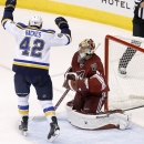 St. Louis Blues' David Backes (42) celebrates a goal by teammate Jaden Schwartz against Arizona Coyotes' Mike Smith, right, during the second period of an NHL hockey game Saturday, Oct. 18, 2014, in Glendale, Ariz The Associated Press