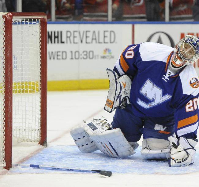 New York Islanders goalie Evgeni Nabokov (20) gets up from falling to the ice after New Jersey Devils' Adam Henrique scored in the first period of an NHL hockey game on Saturday, March 1, 2014, in Uniondale, N.Y. The Devils won 6-1